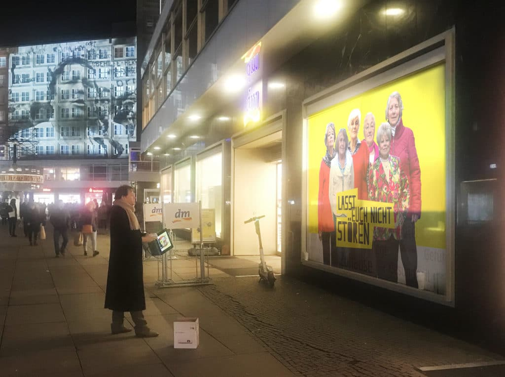 David-Graeber-with-a-projector-for-the-November-9-action-in-Alexanderplatz.-Image-courtesy-the-Yes-Women